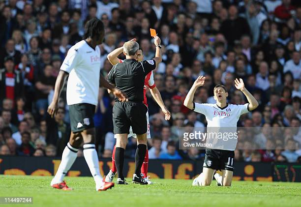 Zoltan Gera of Fulham is shown the red card during the Barclays Premier League match between Fulham and Arsenal at Craven Cottage on May 22 2011 in...
