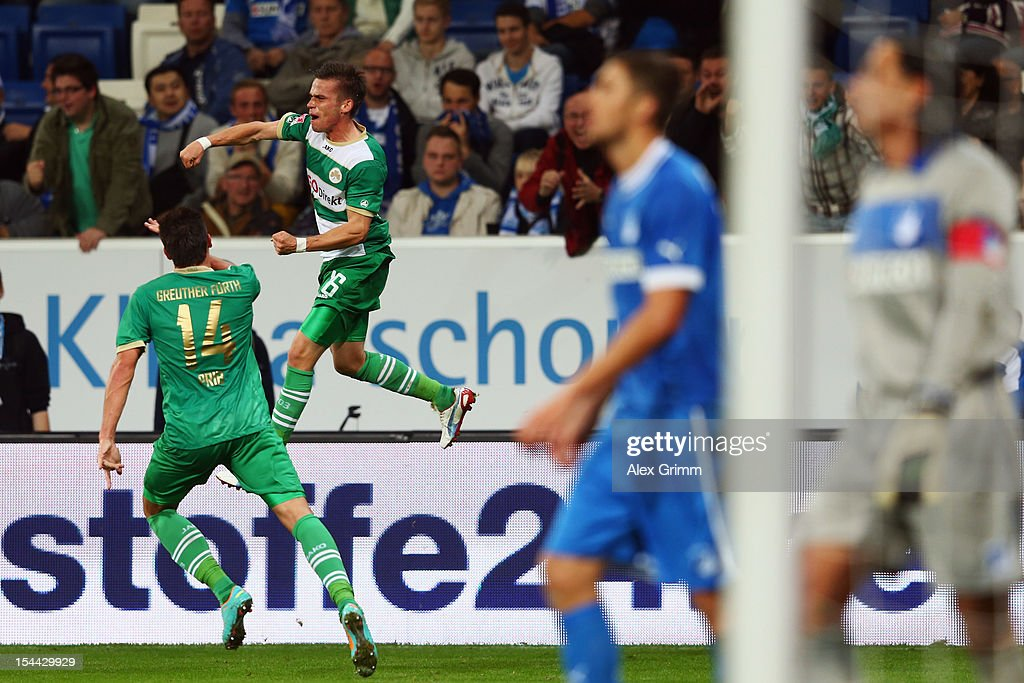 Zoltan Stieber (back) of Greuther Fuerth celebrates his team's first goal with team mate Edgar Prib as <a gi-track='captionPersonalityLinkClicked' href=/galleries/search?phrase=Matthieu+Delpierre&family=editorial&specificpeople=707637 ng-click='$event.stopPropagation()'>Matthieu Delpierre</a> and goalkeeper <a gi-track='captionPersonalityLinkClicked' href=/galleries/search?phrase=Tim+Wiese&family=editorial&specificpeople=635015 ng-click='$event.stopPropagation()'>Tim Wiese</a> of Hoffenheim react during the Bundesliga match between 1899 Hoffenheim and SpVgg Greuther Fuerth at Rhein-Neckar-Arena on October 19, 2012 in Sinsheim, Germany.