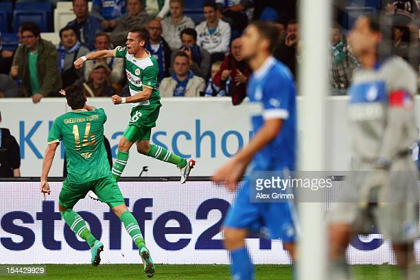 Zoltan Stieber of Greuther Fuerth celebrates his team's first goal with team mate Edgar Prib as Matthieu Delpierre and goalkeeper Tim Wiese of...