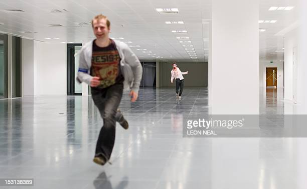 A 'zombie' actor chases participants through a new office development during the last of three nights of the zombie chase game '28 Hours Later' in...
