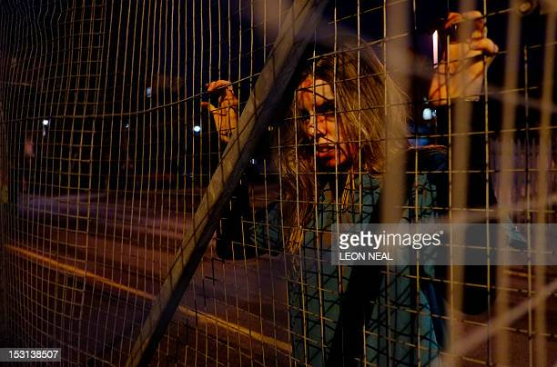 A 'zombie' actor waits for participants during the last of three nights of the zombie chase game '28 Hours Later' in central Manchester northern...