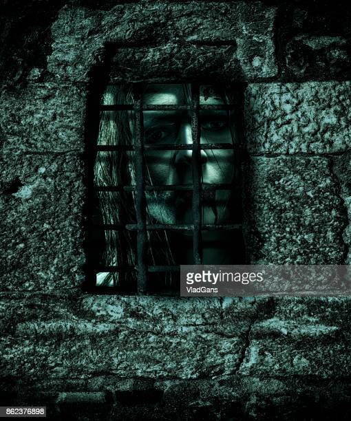 zombie behind the prison bars