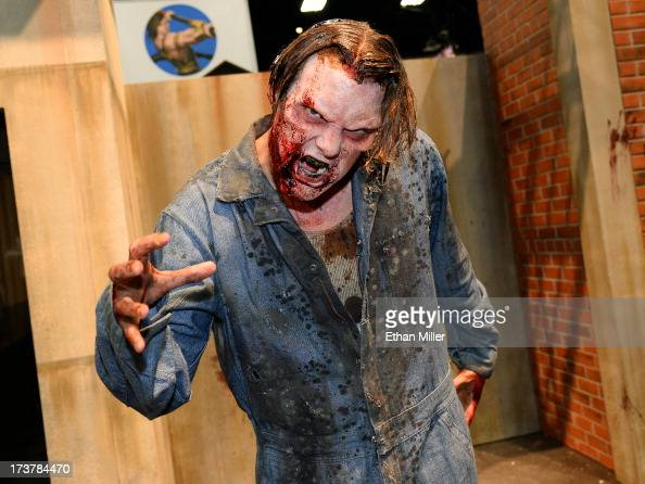 A zombie character poses at the booth for the television series 'The Walking Dead' during ComicCon International 2013 at the San Diego Convention...