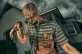 Zombie coming out of an old abandoned house