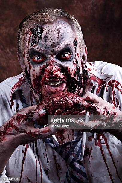 Zombie Eating Stock Photos and Pictures | Getty Images
