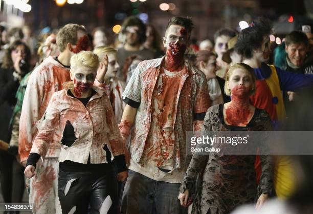 Zombie enthusiasts set out on a 'Zombie Walk' in the city center on October 27 2012 in Berlin Germany Approximately 150 zombies who had organized...