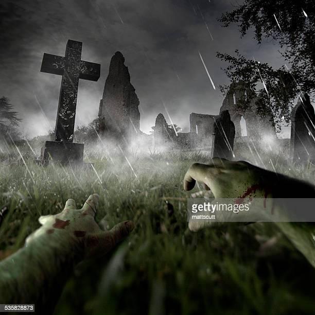 Zombie hands on graveyard