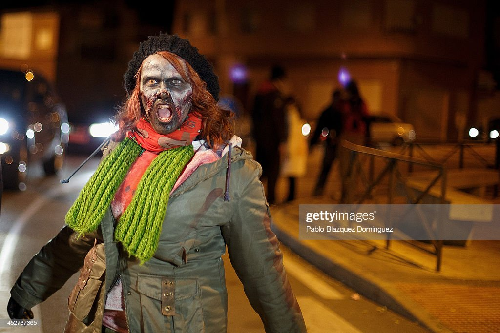 A zombie walks the streets during Zombie Survival contest on December 1, 2013 in Alameda de la Sagra, near Toledo, Spain. 'Zombie Survival' is a contest taking place all around Alameda de la Sagra where participants have to avoid getting touched by Zombies and find all clues to survive. The winners will leave the village by helicopter.