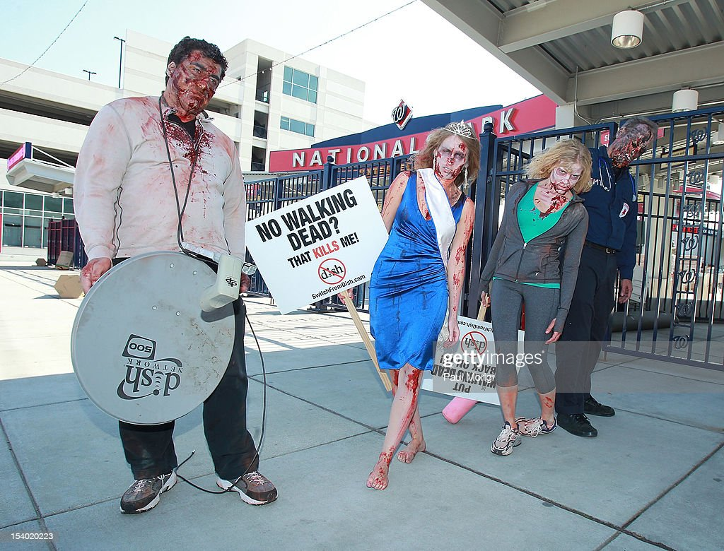 Zombies unite on the eve of World Zombie Day at Nationals Park, ballpark for the Washington Nationals of MLB, to persuade DISH Network to return AMC and its top-rated series 'The Walking Dead' to its line-up on October 12, 2012 in Washington, DC. Season three of 'The Walking Dead' returns to AMC on all cable and satellite networks, except for DISH, on Sunday, October 14, 2012.