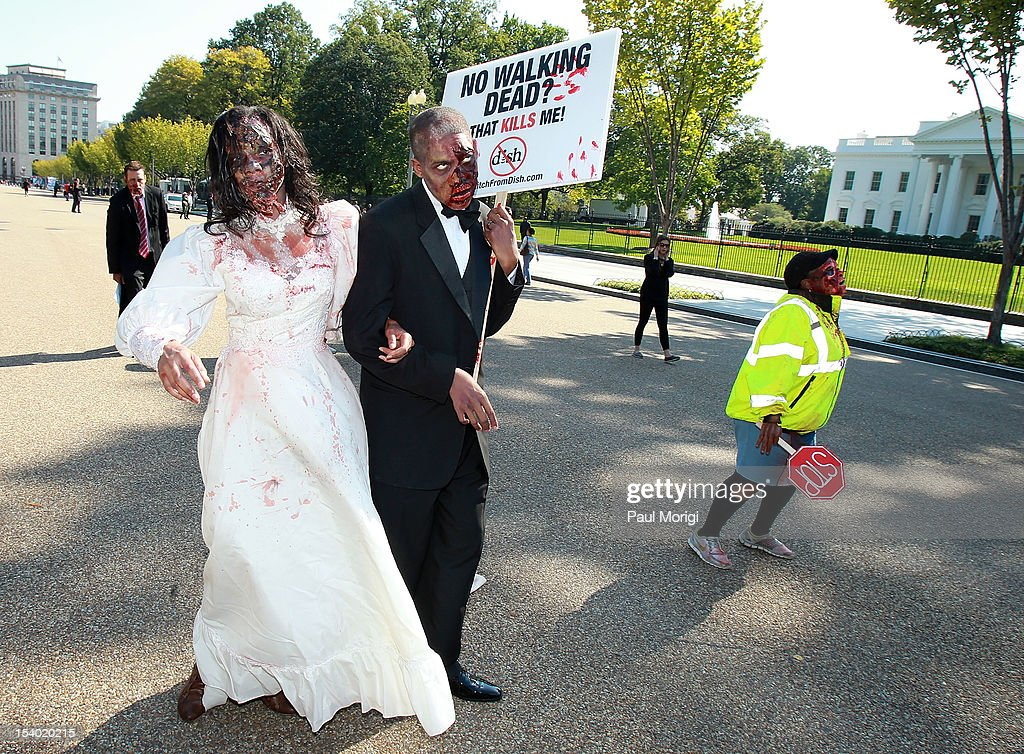 Zombies unite on the eve of World Zombie Day in front of the White House to persuade DISH Network to return AMC and its top-rated series 'The Walking Dead' to its line-up on October 12, 2012 in Washington, DC. Season three of 'The Walking Dead' returns to AMC on all cable and satellite networks, except for DISH, on Sunday, October 14, 2012.