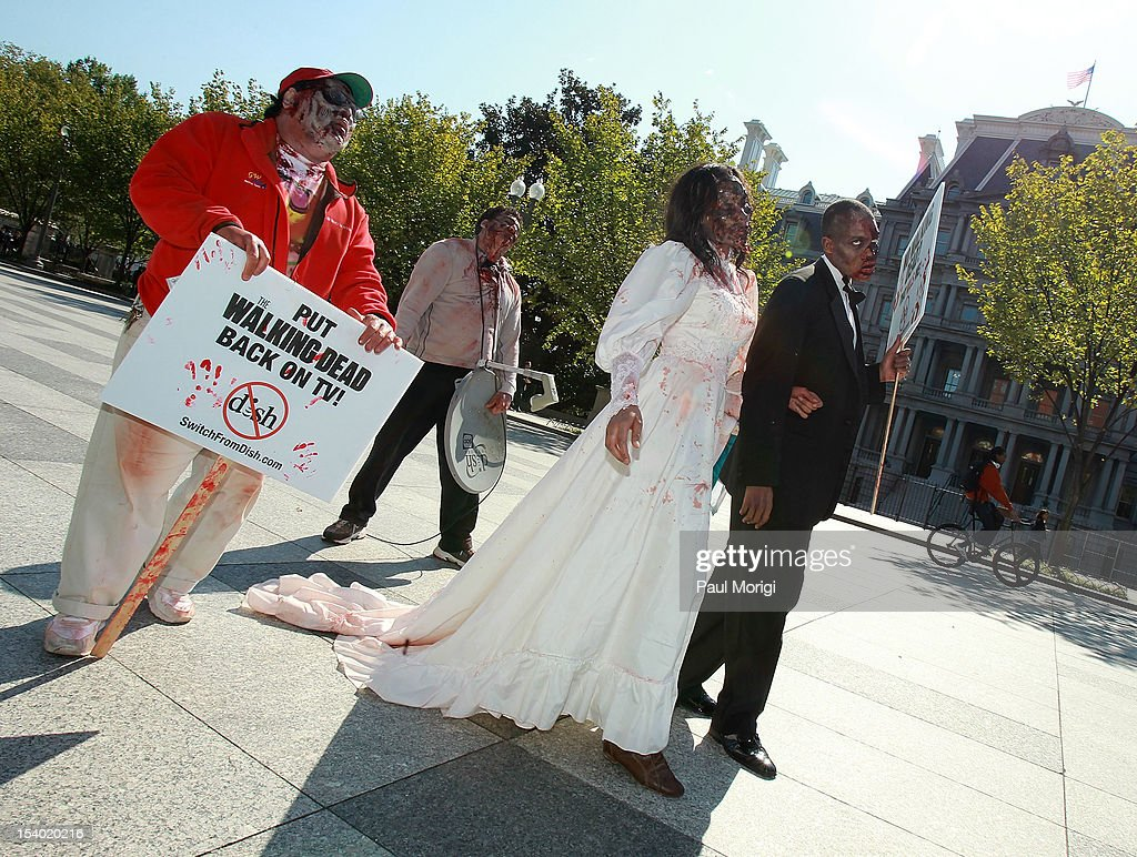 Zombies unite on the eve of World Zombie Day in front of the White House and the Eisenhower Executive Office Building to persuade DISH Network to return AMC and its top-rated series 'The Walking Dead' to its line-up on October 12, 2012 in Washington, DC. Season three of 'The Walking Dead' returns to AMC on all cable and satellite networks, except for DISH, on Sunday, October 14, 2012.