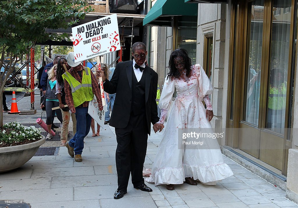 Zombies unite on the eve of World Zombie Day on the streets of Washington, DC to persuade DISH Network to return AMC and its top-rated series 'The Walking Dead' to its line-up on October 12, 2012 in Washington, DC. Season three of 'The Walking Dead' returns to AMC on all cable and satellite networks, except for DISH, on Sunday, October 14, 2012.