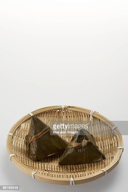 Zongzi in a woven bowl