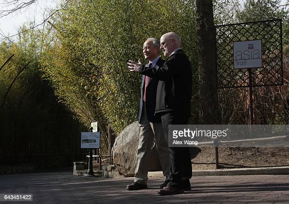 Zoo Director Dennis Kelly talks to Chinese Ambassador Cui Tiankai as they wait for the departure of Giant panda Bao Bao at the Smithsonian's National...