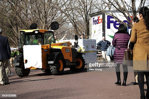 Zoo keepers escort the transport crate holding giant panda Bao Bao moved by a forklift up a path for loading into a Fedex Truck at the Smithsonian's...