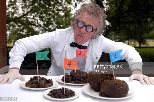 Zoo worker Roger Tomlinson checks animal dung at London Zoo in Regent's Park ahead of an exhibition there this weekend called 'Zoo Poo' which will...