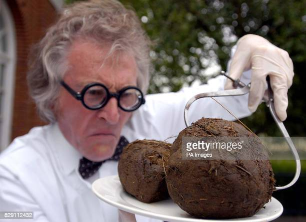 Zoo worker Roger Tomlinson measures elephantdung at London Zoo in Regent's Park ahead of an exhibition there this weekend called 'Zoo Poo' which will...