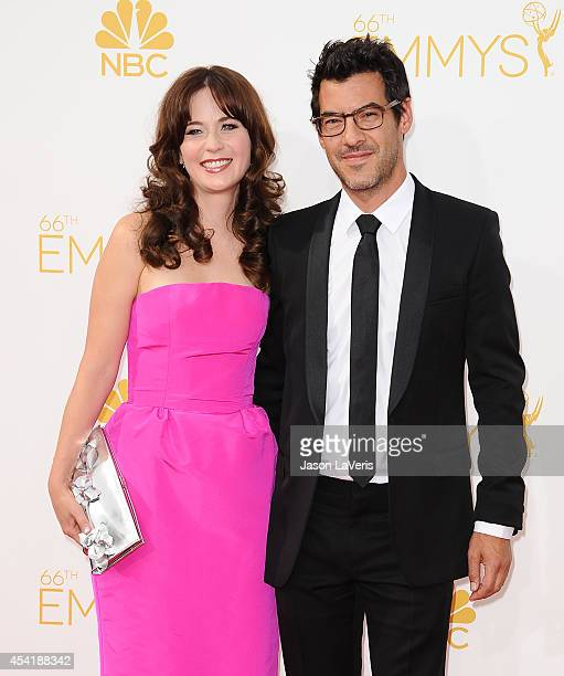 Zooey Deschanel and Jacob Pechenik attend the 66th annual Primetime Emmy Awards at Nokia Theatre LA Live on August 25 2014 in Los Angeles California