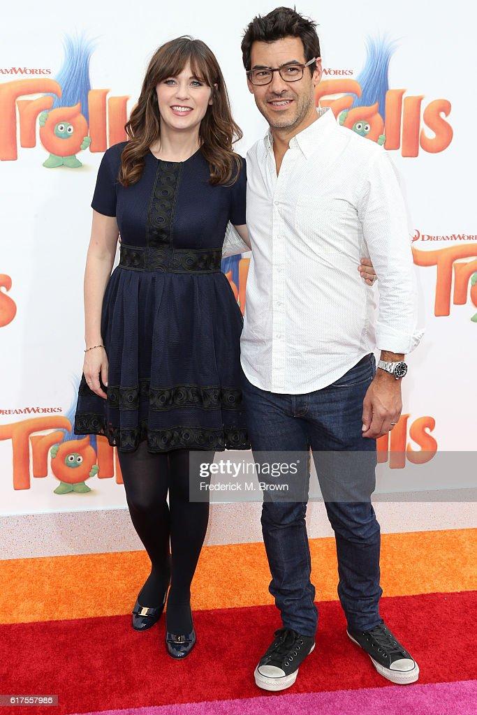 Zooey Deschanel and Jacob Pechenik attend the premiere of 20th Century Fox's 'Trolls' at Regency Village Theatre on October 23, 2016 in Westwood, California.