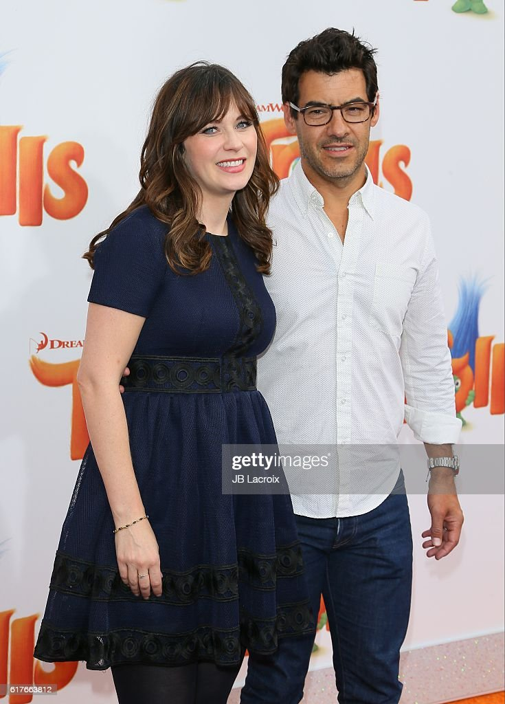 Zooey Deschanel and Jacob Pechenik attend the premiere of 20th Century Fox's 'Trolls' on October 23, 2016 in Westwood, California.