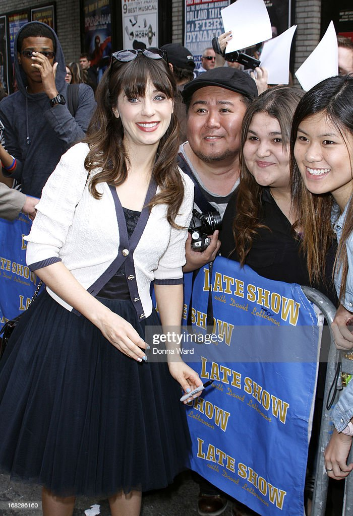<a gi-track='captionPersonalityLinkClicked' href=/galleries/search?phrase=Zooey+Deschanel&family=editorial&specificpeople=202927 ng-click='$event.stopPropagation()'>Zooey Deschanel</a> greets fans at the 'Late Show with David Letterman' at Ed Sullivan Theater on May 7, 2013 in New York City.