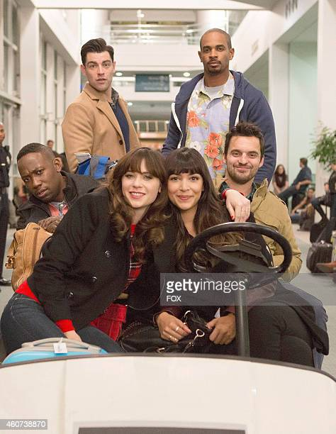 Zooey Deschanel Lamorne Morris Max Greenfield Damon Wayans Jr Jake Johnson and Hannah Simone in the 'LAXmas' episode of NEW GIRL airing Tuesday Dec 9...