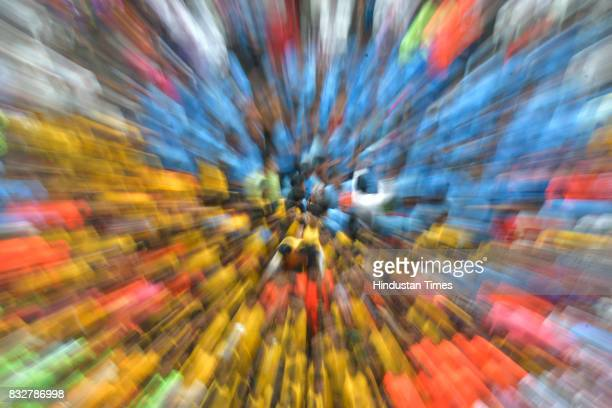 Zoom blur shot of Govindas trying to form human pyramid during Dahi Handi celebration at Ghatkopar on the occasion of Krishna Janmashtmi on August 15...