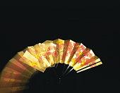 Zoom effect on gold Japanese fan
