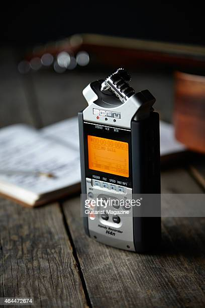 A Zoom H4n digital recorder photographed alongside a notepad and Sigma acoustic guitar for a feature on songwriting taken on May 21 2014