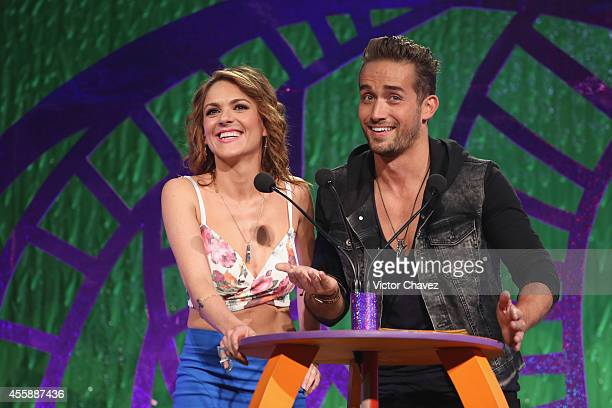 Zoraida Gómez and Mauricio Henao speak onstage during the Nickelodeon Kids' Choice Awards Mexico 2014 at Pepsi Center WTC on September 20 2014 in...