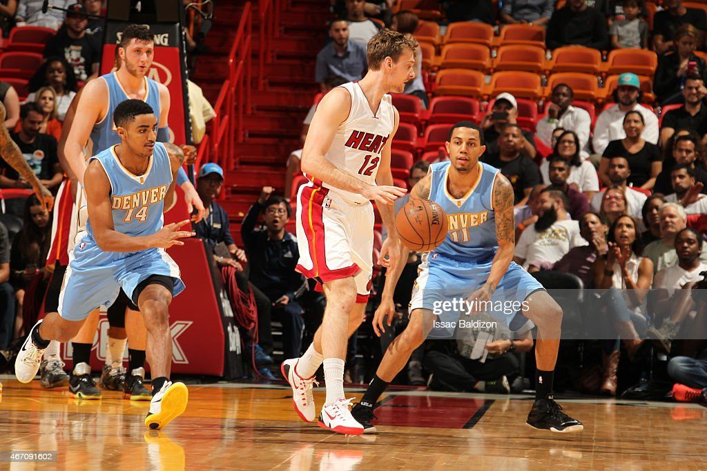 Zoran Dragic #12 of the Miami Heat handles the ball against <a gi-track='captionPersonalityLinkClicked' href=/galleries/search?phrase=Erick+Green&family=editorial&specificpeople=7348606 ng-click='$event.stopPropagation()'>Erick Green</a> #11 of the Denver Nuggets on March 20, 2015 at American Airlines Arena in Miami, Florida.