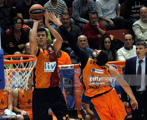 Zoran Ercceg #7 of Galatasaray Liv Hospital Istanbul competes with Bojan Dubljevic #14 of Valencia Basket in action during the 20142015 Turkish...