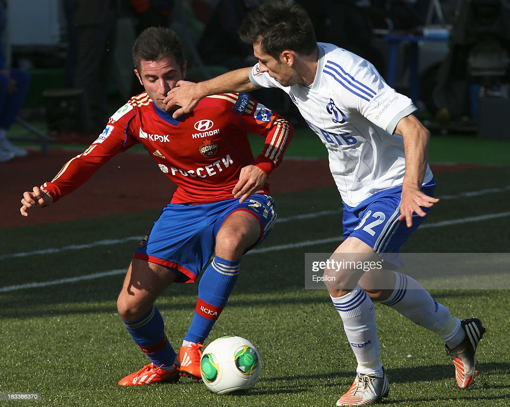 Zoran Toshich of PFC CSKA Moscow is challenged by Lomich of FC Dinamo Moscow during the Russian Premier League match between PFC CSKA Moscow and FC Dinamo Moscow on October 6, 2013 in Moscow, Russia. (Photo b /Epsilon/Getty Images)ZMarko Lomich;Zoran Toshich