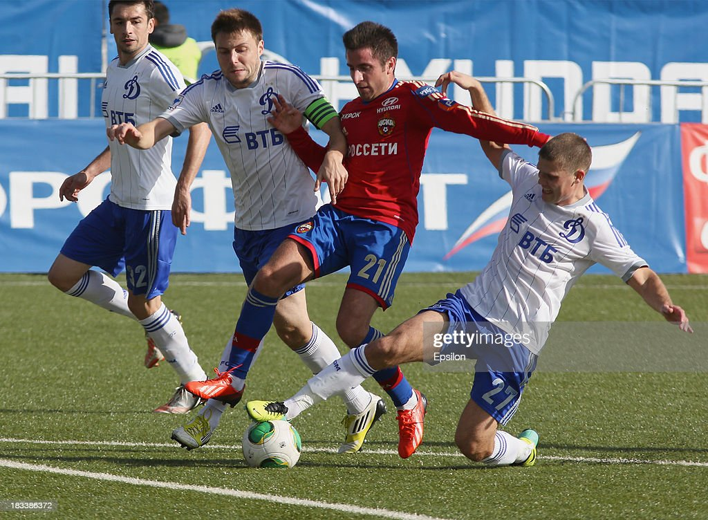 Zoran Toshich of PFC CSKA Moscow is challenged by Vladimir Granat (L) and Igor Denisov (R) of FC Dinamo Moscow during the Russian Premier League match between PFC CSKA Moscow and FC Dinamo Moscow on October 6, 2013 in Moscow, Russia. (Photo b /Epsilon/Getty Images)Zoran Toshich;