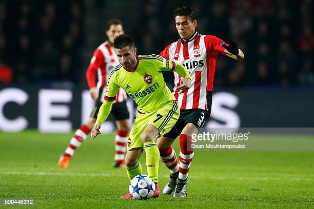 Zoran Tosic of CSKA battles for the ball with p3 of PSV during the group B UEFA Champions League match between PSV Eindhoven and CSKA Moscow held at...