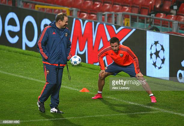 Zoran Tosic of CSKA Moscow talks with the coach Leonid Slutski during a training session at Old Trafford on November 2 2015 in Manchester England