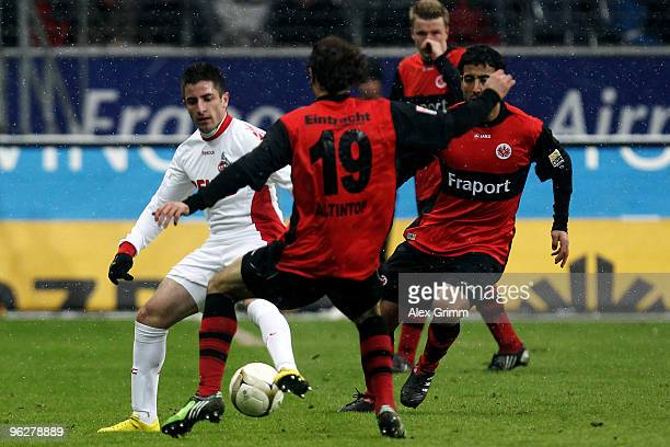 Zoran Tosic of Koeln is challenged by Halil Altintop of Frankfurt during the Bundesliga match between Eintracht Frankfurt and 1 FC Koeln at the...