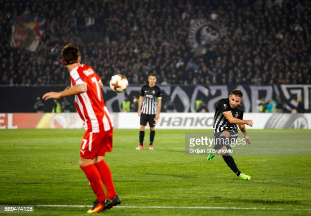 Zoran Tosic of Partizan scores the goal from the free kick during the UEFA Europa League group B match between Partizan and KF Skenderbeu at on...