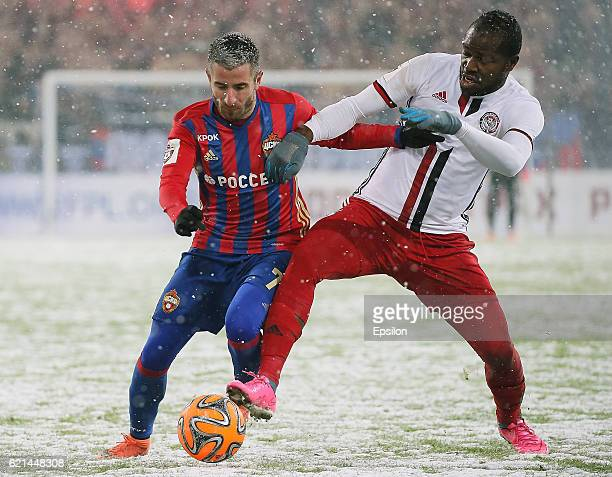 Zoran Tosic of PFC CSKA Moscow challenged by Brian Idowu of FC Amkar Perm during the Russian Premier League match between PFC CSKA Moscow and FC...