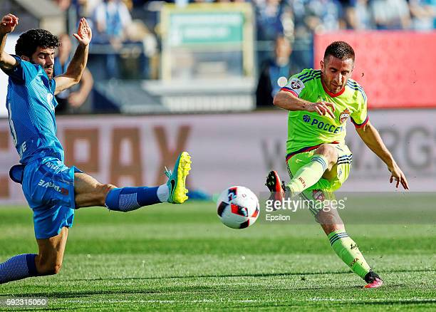Zoran Tosic of PFC CSKA Moscow shoots the ball as Luis Neto of FC Zenit St Petersburg defends during the Russian Football League match between FC...