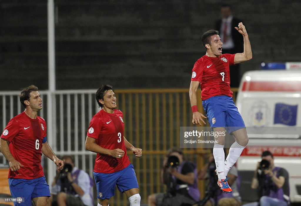 Zoran Tosic (R) of Serbia celebrates scoring a goal with team-mates Branislav Ivanovic (L) and Ljubomir Fejsa (C) during the FIFA 2014 World Cup Qualifier at stadium Karadjordje Park between Serbia and Wales on September 11, 2012 in Novi Sad, Serbia