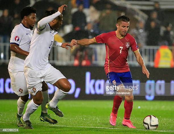 Zoran Tosic of Serbia in action against Bruno Alves of Portugal during the Euro 2016 qualifying football match between Serbia and Portugal at the...