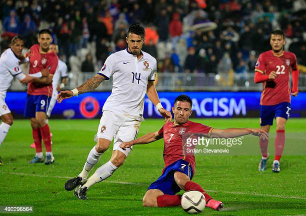 Zoran Tosic of Serbia in action against Jose Fonte of Portugal during the Euro 2016 qualifying football match between Serbia and Portugal at the...