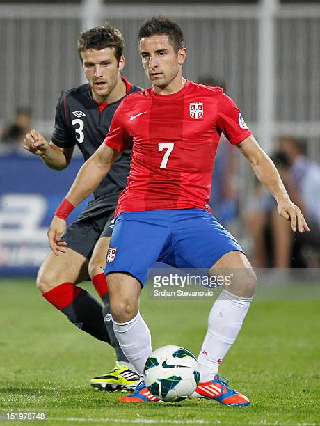 Zoran Tosic of Serbia shields the ball from Adam Matthews of Wales during the FIFA 2014 World Cup Qualifier at stadium Karadjordje Park between...