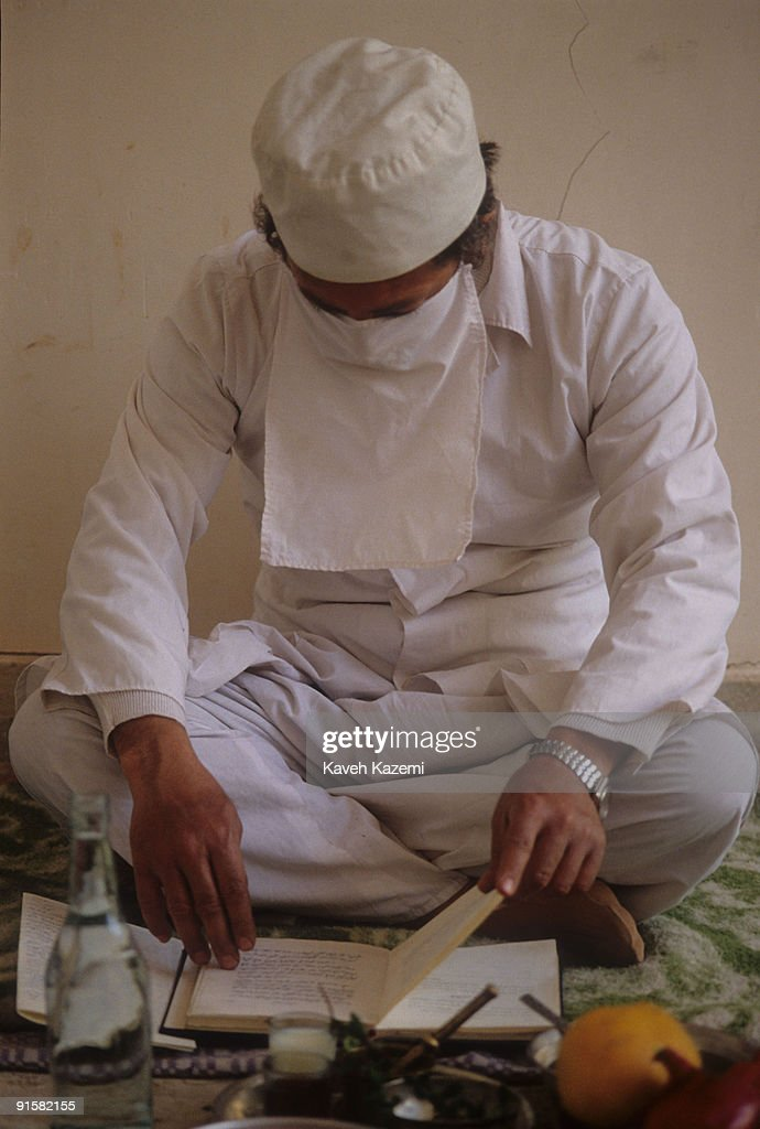 Zoroastrian Mobed (priest) Balivani reads from The Zoroastrian holy book, or Avesta while blessing the fruit brought to him for that purpose by local people on <a gi-track='captionPersonalityLinkClicked' href=/galleries/search?phrase=Zarathustra&family=editorial&specificpeople=980587 ng-click='$event.stopPropagation()'>Zarathustra</a>'s birthday, Sharifabad near Ardakan, Iran, 26th March 1995.