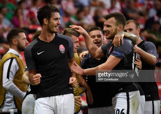 Zorya Louhansk's midfielder from Ukraine Ihor Kharatin celebrates with teammates after scoring his team's first goal during the UEFA Europa league...