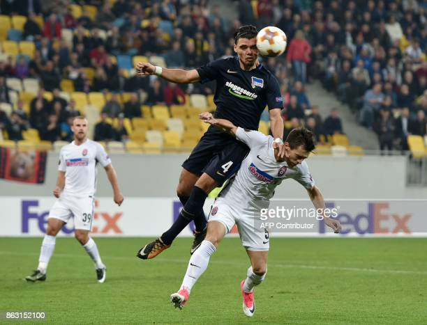 Zorya's Artem Gordiyenko and Hertha BSC Berlin's Karim Rekik vie for the ball during the UEFA Europa League Group J football match between FC Zorya...