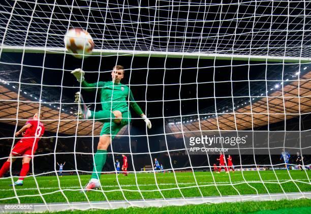 Zorya's goalkeeper Andriy Lunin kicks the ball in frustration after failing to save a goal by Hertha Berlin's forward Davie Selke during the UEFA...