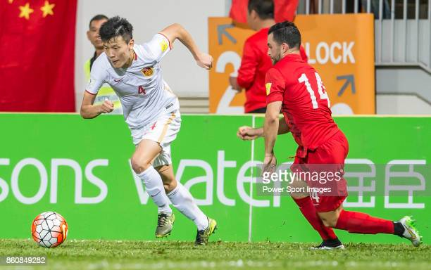 Zou Zheng of China PR fights for the ball with Jonathan Sealy of Hong Kong during their FIFA World Cup Qualifiers 2015 match between Hong Kong and...