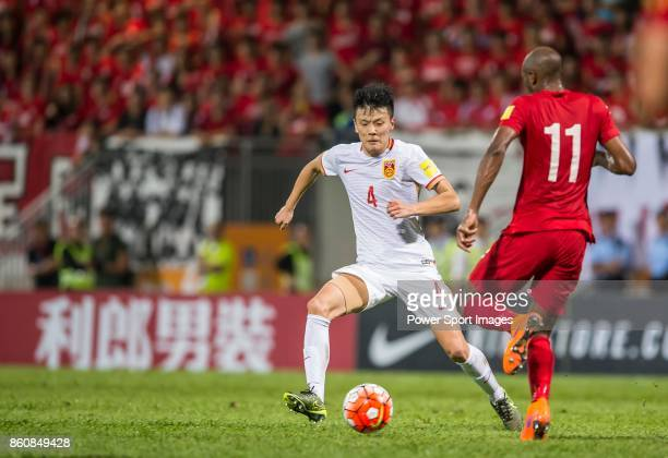 Zou Zheng of China PR fights for the ball with Sandro of Hong Kong during their FIFA World Cup Qualifiers 2015 match between Hong Kong and China PR...